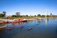 the harbor in the district Deutz, Severins bridge across the river Rhine, the cathedral, kayakers, Cologne, Germany.<br /> <br /> Deutzer Hafen, Severinsbruecke, der Dom, Kajakfahrer, Koeln, Deutschland.
