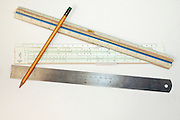3 types of rulers, regular, slid and scale with a pencil, used for planning and design work