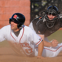 Princeton catcher Tyler Servais (#29) tags out Rutgers right fielder Steve Zavala (#17) at home plate during Rutgers 12-11 walk-off homerun victory over  Princeton in NCAA college baseball at Bainton Field in Piscataway, N.J.