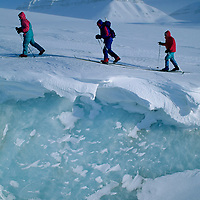 SPITSBERGEN, Norway, Expedition skiers & crevasse on Nordenskiold Glacier. (80 deg.N.lat.)(MR)