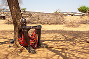 Mature man of the Samburu tribe. The Samburu are a Nilotic people of north-central Kenya. Samburu are semi-nomadic pastoralists who herd mainly cattle but also keep sheep, goats and camels.