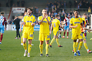 Wimbledon players applaud the fans at full time during the EFL Sky Bet League 1 match between Scunthorpe United and AFC Wimbledon at Glanford Park, Scunthorpe, England on 30 March 2019.
