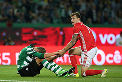 April 22, 2017 - Lisbon, Portugal - Sporting's Dutch forward Bas Dost (L) and Benfica's Swedish defender Victor Lindelof (R ) during the Portuguese League football match Sporting CP vs SL Benfica at the Alvadade stadium in Lisbon on April 22, 2017. (Credit Image: © Pedro Fiuza/NurPhoto via ZUMA Press)