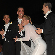 Ga'ti Bala'zs, from left, with dance partner Csaba Csetneki, both of Hungary, and Pascal Herrbach, of Berlin, Germany, with dance partner Gergely Darabos, of Budapest, Hungary, react to the announcement that they are the two finalists in the adult men's standard A division of the same-sex ballroom dancing competition during the 2007 Eurogames at the Waagnatie hangar in Antwerp, Belgium on July 13, 2007. ..Herrbach and Darabos won the championship. ..Over 3,000 LGBT athletes competed in 11 sports, including same-sex dance, during the 11th annual European gay sporting event. Same-sex ballroom is a growing sports that has been happening in Europe for over two decades.