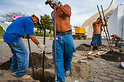 """07 JANUARY 2007 - MANAGUA, NICARAGUA: Men work on the inaugural stage for incoming Nicaraguan president, Daniel Ortega, of the Sandanista party. The Sandanistas won the November election and took power in January, 17 years after they were swept from power by the UNO opposition coalition headed by Violetta Chamorro. The Sandanistas ruled Nicaragua from 1979 to 1990 after they defeated the Somoza government. Their tenure was marked by advances in education and health care, but also by a war against the """"Contras"""" an anti-Sandanista army organized and funded by the Reagan administration.   Photo by Jack Kurtz"""