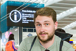 Charles Thorbur, 31, a banking executive working in Berlin is desperate to get back to the German city for work, but his flight has been cancelled at Terminal 5 at Heathrow Airport after an IT glitch brings British Airways systems to a halt, causing disruption to thousands of passengers with flights cancelled and delayed. London, August 07 2019.