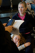 "A market researcher working for the Heathrow Aiport operator BAA, conducts her surveys in the departures concourses of this aviation hub's terminal 5. Asking very detailed but brief questions of this young mother and her rather suspicious daughter, both travelling to the US, the unseen woman employee samples opinion on the airport's performance and the passengers overall experience of using this airport. Terminal 5 has the capacity to serve around 30 million passengers a year and by analysing the data from these surveys helps the operator discover room for improvement. From writer Alain de Botton's book project ""A Week at the Airport: A Heathrow Diary"" (2009)."