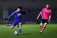 AFC Wimbledon attacker Ryan Longman (29) crossing the ball during the EFL Sky Bet League 1 match between AFC Wimbledon and Peterborough United at Plough Lane, London, United Kingdom on 2 December 2020.