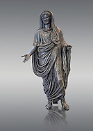 Roman bronze staue of Augustus Ceasar as Pontifex Maximus, late first century B.C, Naples National Archaeological Museum, grey background .<br /> <br /> If you prefer to buy from our ALAMY STOCK LIBRARY page at https://www.alamy.com/portfolio/paul-williams-funkystock/greco-roman-sculptures.html . Type -    Naples    - into LOWER SEARCH WITHIN GALLERY box - Refine search by adding a subject, place, background colour, etc.<br /> <br /> Visit our ROMAN WORLD PHOTO COLLECTIONS for more photos to download or buy as wall art prints https://funkystock.photoshelter.com/gallery-collection/The-Romans-Art-Artefacts-Antiquities-Historic-Sites-Pictures-Images/C0000r2uLJJo9_s0