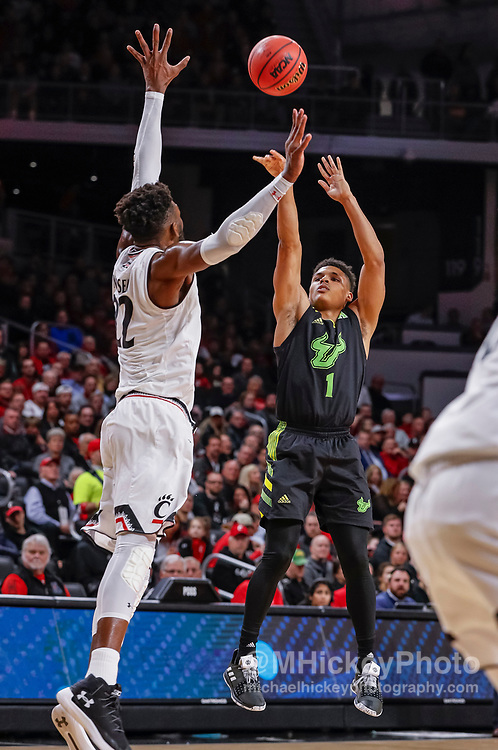 CINCINNATI, OH - JANUARY 15: Xavier Castaneda #1 of the South Florida Bulls shoots the ball against Eliel Nsoseme #22 of the Cincinnati Bearcats during the first half of the game at Fifth Third Arena on January 15, 2019 in Cincinnati, Ohio. (Photo by Michael Hickey/Getty Images) *** Local Caption *** Xavier Castaneda; Eliel Nsoseme