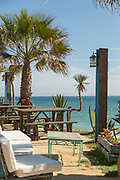 Chairs and tables with sea in background, Cadiz, Andalusia, Spain