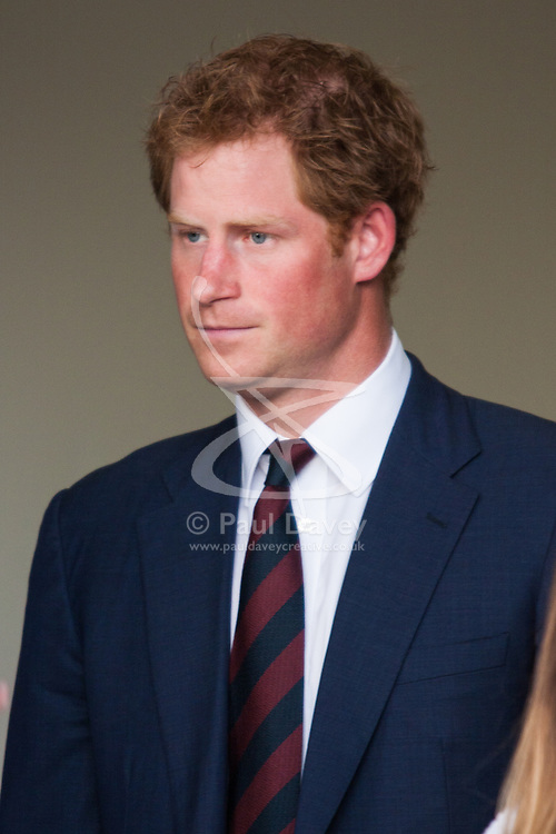 Queen Elizabeth Olympic Park, London, September 10th 2014. Prince Harry waits for the arrival of his father, Prince Charles  ahead of the opening ceremony for the Invictus Games, where over 400 competitors from 13 nations will take part in an international sporting event for wounded, injured and sick Servicemen and women.