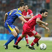 Turkey's Selcuk INAN (R) during their UEFA EURO 2012 Qualifying round Group A soccer match Turkey betwen Kazakhstan at TT Arena Istanbul September 02, 2011. Photo by TURKPIX