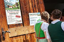 29.04.2018, Maishofen, AUT, XII Weltkongress Pinzgauer Rind, im Bild zwei junge Frauen mit Dirndl und Flechtfrisur vor der Eingangstür zur Versteigerungshalle // Two young women with dirndls and braided hair in front of the entrance door to the auction hall during the XII Pinzgauer cattle World Congress in Maishofen, Austria on 2018/04/29. EXPA Pictures © 2018, PhotoCredit: EXPA/ Stefanie Oberhauser