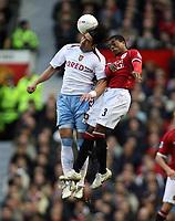 Photo: Paul Thomas.<br /> Manchester United v Aston Villa. The FA Cup. 07/01/2007.<br /> <br /> Juan Pablo Angel (L) of Villa wins a header from Patrice Evra.