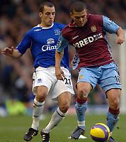 Photo: Paul Greenwood.<br />Everton v Aston Villa. The Barclays Premiership. 11/11/2006. Everton's Leon Osman, left, battles with Villa's Wilfred Bouma