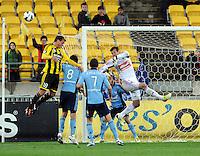 phoenix's Ben Sigmund misses a header against the Sydney FC keeper Ivan Necevski in the A-League foootball match at Westpac Stadium, Wellington, New Zealand, Saturday, October 06, 2012. Credit:SNPA / Ross Setford