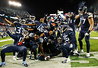 NASHVILLE, TN - DECEMBER 6: Derrick Henry #22 of the Tennessee Titans celebrates a touchdown with his teammates during the fourth quarter against the Jacksonville Jaguars at Nissan Stadium on December 6, 2018 in Nashville, Tennessee. (Photo by Frederick Breedon/Getty Images)