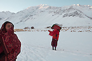 Wakhi women bringing cloth for cleaning, at  Sarhad village, the end of the road in the Wakhan Corridor.