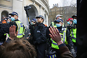 Kill the Bill demonstration in Central London against the proposed Police, Crime, Sentencing and Courts Bill on the 3rd April 2021, London, United Kingdom. Police forming a protective cordon around fellow officers arresting protesters. At one point the officers draw their battons threatening to strike protesters to make them step back. After the protest ended in Parliament Square police cleared the streets, arresting several in the process. Thousands turned out in London and across the UK to show their objection to the Governments proposed bill. Many fear the bill is meant to suppress acts of protesting and demonstrations. The police will be given greater powers to prevent and stop actions of civil disobedience and peaceful protests and many see this as a suppression of their civil liberties. Sentencing for acts of peaceful protest is also likely to be much harsher and that may also act as a deterrent to protest.
