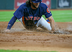 April 29, 2018 - Houston, TX, U.S. - HOUSTON, TX - APRIL 29:  Houston Astros center fielder Jake Marisnick (6) slides into home plate and scores in the bottom of the third inning during the baseball game between the Oakland Athletics and Houston Astros on April 29, 2018 at Minute Maid Park in Houston, Texas.  (Photo by Leslie Plaza Johnson/Icon Sportswire) (Credit Image: © Leslie Plaza Johnson/Icon SMI via ZUMA Press)