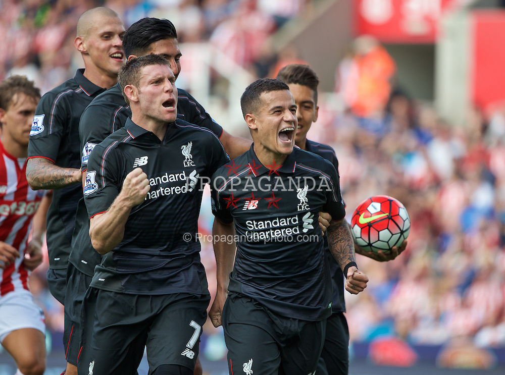 STOKE-ON-TRENT, ENGLAND - Sunday, August 9, 2015: Liverpool's Philippe Coutinho Correia celebrates scoring the winning goal against Stoke City with team-mates James Milner, Martin Skrtel, Emre Can and Roberto Firmino during the Premier League match at the Britannia Stadium. (Pic by David Rawcliffe/Propaganda)