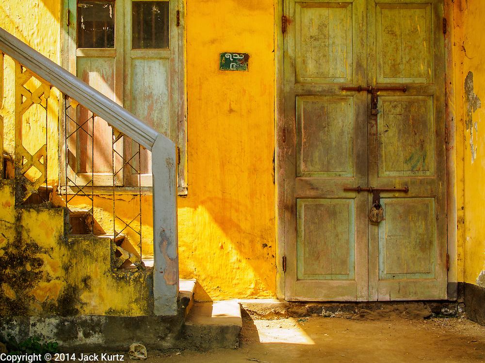 09 NOVEMBER 2014 - SITTWE, RAKHINE, MYANMAR:   A stairway and door on a private home in Sittwe, Myanmar. Sittwe is a small town in the Myanmar state of Rakhine, on the Bay of Bengal. PHOTO BY JACK KURTZ