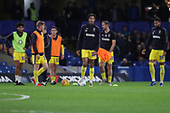 AFC Wimbledon striker Jake Jervis (10), AFC Wimbledon defender Toby Sibbick (20), AFC Wimbledon midfielder Alfie Eagan (28) warming up during the EFL Trophy match between U21 Chelsea and AFC Wimbledon at Stamford Bridge, London, England on 4 December 2018.