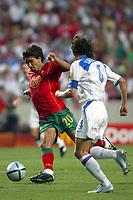Lisbon 16/6/2004 Euro2004 <br />RUSSIA PORTUGAL 0-2<br />Deco of Portugal and Alexei Smertin of Russia <br />Photo Graffiti