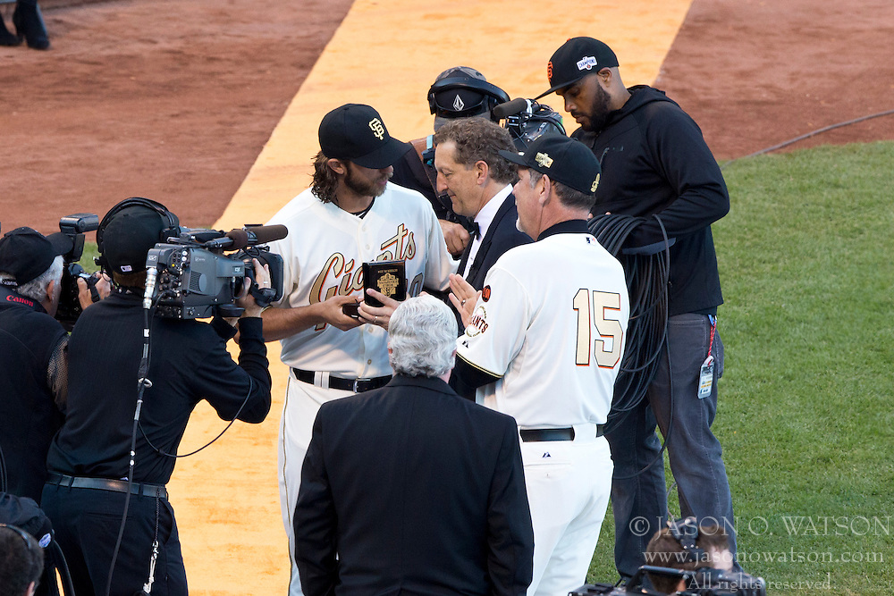 SAN FRANCISCO, CA - APRIL 18:  Madison Bumgarner #40 of the San Francisco Giants is presented with his World Series ring by Larry Baer and manager Bruce Bochy #15 during the  2014 World Series Ring ceremony before the game against the Arizona Diamondbacks at AT&T Park on April 18, 2015 in San Francisco, California.  (Photo by Jason O. Watson/Getty Images) *** Local Caption *** Madison Bumgarner; Larry Baer, Bruce Bochy