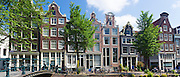 Bicycles and canalside gabled houses - Dutch gables - Milkmaid's Bridge Melkmeisjesbrug on Brouwersgracht, Amsterdam, Holland