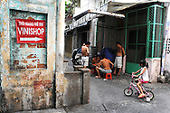 Neighbors play chinese chess in a small alley, Ho Chi Minh City, Vietnam, Southeast Asia