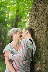 Mature couple kissing in forest