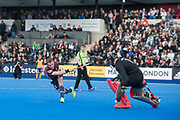 Wimbledon's Ian Sloan sees his shot saved by Harry Gibson in the shoot out. Wimbledon v Surbiton - Men's Hockey League Final, Lee Valley Hockey & Tennis Centre, London, UK on 23 April 2017. Photo: Simon Parker