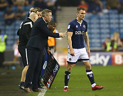 April 20, 2018 - London, United Kingdom - Neil Harris manager of Millwall having words with Jed Wallace of Millwall.during Championship match between Millwall against Fulham at The Den stadium, London  England on 20 April   2018. (Credit Image: © Kieran Galvin/NurPhoto via ZUMA Press)