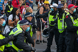 © Licensed to London News Pictures.  24/07/2021. London, UK. Police despair anti-vaccination protesters who block the street in Parliament Square, central London during Freedom Rally.  Photo credit: Marcin Nowak/LNP