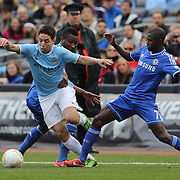 Samir Nasri, Manchester City, gets past Ramires (right) and John Obi Mikel during the Manchester City V Chelsea friendly exhibition match at Yankee Stadium, The Bronx, New York. Manchester City won the match 5-3. New York. USA. 25th May 2012. Photo Tim Clayton