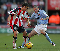 Photo: Lee Earle.<br /> Southampton v Hull City. Coca Cola Championship. 04/11/2006. Hull's Dean Marney (R) battles with Rudi Skacel.