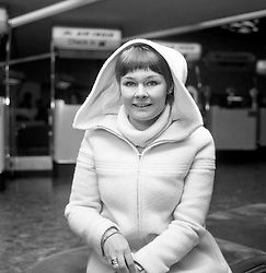 Actress Judi Dench at Heathrow Airport, where she was due to fly to Japan with the Royal Shakespeare Company. The company will give performances of Othello, Twelfth Night and Henry V at Tokyo's Nissei Theatre.