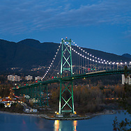 Evening photograph of Lions Gate Bridge in Vancouver, British Columbia, Canada.  Photographed from Prospect Point in Stanley Park.