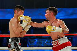Lee Haskins (white shorts, red trim) on his way to victory over Ryosuke Iwasa (black and printed shorts) by 6th Round stoppage to win the Interim IBF World Bantamweight Title Fight in his home City of Bristol - Photo mandatory by-line: Rogan Thomson/JMP - 07966 386802 - 13/06/2015 - SPORT - BOXING - Bristol, England - Action Indoor Sports Arena - Lee Haskins vs Ryosuke Iwasa - Interim IBF World Bantamweight Title Fight.