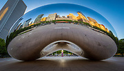 Cloud Gate is a public sculpture by Indian-born British artist Anish Kapoor, that is the centerpiece of AT&T Plaza at Millennium Park in the Loop community area of Chicago, Illinois. The sculpture and AT&T Plaza are located on top of Park Grill, between the Chase Promenade and McCormick Tribune Plaza & Ice Rink. Constructed between 2004 and 2006, the sculpture is nicknamed The Bean because of its legume-like shape. Made up of 168 stainless steel plates welded together, its highly polished exterior has no visible seams. It measures 33 by 66 by 42 feet (10 by 20 by 13 m), and weighs 110 short tons (100 t; 98 long tons).