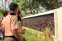 October 1, 2018 - Madiun, East Java, Indonesia - A number of students, local officials and honored guests after the commemoration ceremony of the Pancasila Power Day at the Kresek Monument observed the historical relics of the Indonesian Communist Party / PKI Violence Events in 1948 in Madiun (Credit Image: © Ajun Ally/Pacific Press via ZUMA Wire)