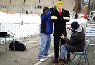 Chris Ihle works on a likeness of U.S. President Donald Trump he made out of 44,000 plastic blocks outside a Trump rally in Des Moines, Iowa, U.S., January 30, 2020. REUTERS/Rick Wilking