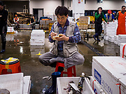 07 JUNE 2018 - SEOUL, SOUTH KOREA:  A fish seller takes notes before the wholesale fish auction in the Noryangjin Fish Market. The auctions start about 01.00 AM and last until 05.00 AM. Noryangjin Fish Market is the largest fish market in Seoul and has been in operation since 1927. It opened in the current location in 1971 and was renovated in 2015. The market serves both retail and wholesale customers and has become a tourist attraction in recent years.    PHOTO BY JACK KURTZ