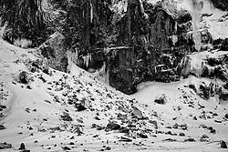 Man walking beneath the cliffs in Vik in Myrdalur, south Iceland - Maður á göngu undir klettum, Vík í Mýrdal