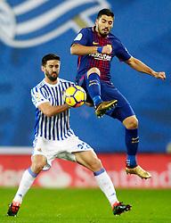Real Sociedad's Raul Navas (l) and FC Barcelona's Luis Suarez during La Liga Real Sociedad v FC Barcelona match in San Sebastian-Donostia, Spain, January 14, 2018. Photo by Acero/AlterPhotos/ABACAPRESS.COM