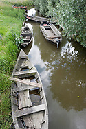 Traditional wooden boats in the Audomarois, aat Les Faiseurs de Bateux – an escute in the foreground, a bâcove in the background on the right. Saint-Omer, Pas-de-Calais, France © Rudolf Abraham