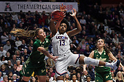 South Florida's Elena Tsineke, left, fouls Connecticut's Christyn Williams (13) during the second half of an NCAA college basketball game in the American Athletic Conference tournament semifinals at Mohegan Sun Arena, Sunday, March 8, 2020, in Uncasville, Conn. (AP Photo/Jessica Hill)