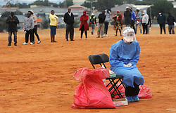 South Africa - Johannesburg - 27 April 2020 - A mediacal pratictioner awaits for patient to test for COVID-19 in Alexandra township, residents gatered to be screened and tested for coronavirus, the campaign is targeting Johannesburg epicenter. <br /> Picture: Itumeleng English/African News Agency(ANA)